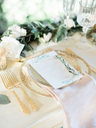 wedding-reception-table-setting-white-menu-card-herb-design-gold-forks-flatware-wood-table