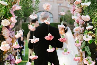 rosebuds-attached-to-string-hang-as-garlands