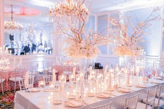 long-wedding-reception-table-with-sequined-linens-ivory-flowers-curly-willow-candles