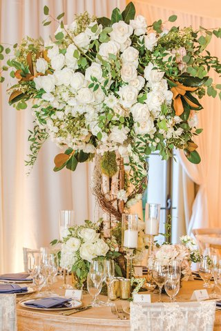 wedding-reception-centerpiece-birch-tree-trunk-growing-into-white-roses-with-greenery