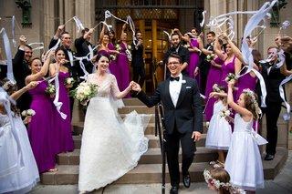 bride-in-lace-v-neck-carolina-herrera-groom-in-ralph-lauren-ribbon-streamers-leavingthe-chapel