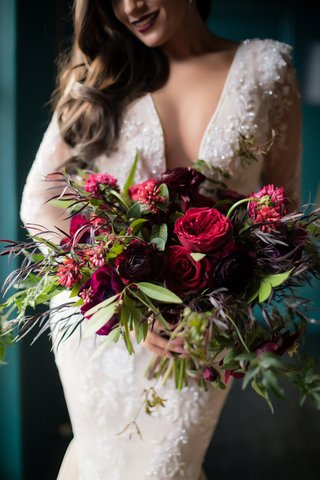 seattle-mariners-marc-rzepczynskis-wedding-bridal-bouquet-with-deep-shades-of-red