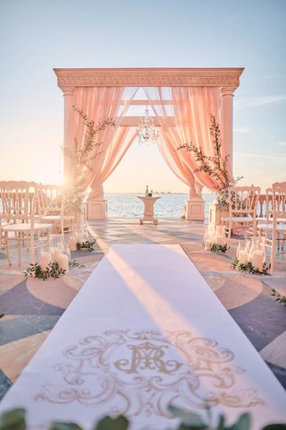 ornate-monogram-on-aisle-runner-for-wedding-ceremony-overlooking-sarasota-bay