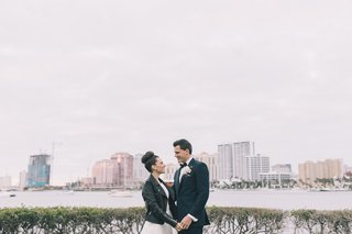 bride-wearing-leather-jacket-over-romona-keveza-gown-palm-beach-wedding