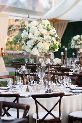 wedding-reception-tent-white-table-wood-vineyard-chairs-tall-centerpiece-spray-rose-hydrangea
