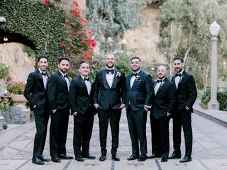 groom-and-groomsmen-in-classic-black-tuxedos-and-bow-ties