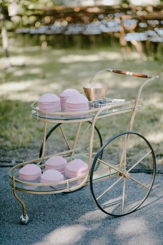 wedding-ceremony-outdoor-vintage-cart-bar-cart-with-pink-yarmulke-jewish-wedding-ceremony