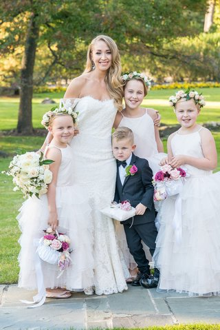 bride-in-off-shoulder-anne-barge-wedding-dress-with-ring-bearer-pillow-and-three-flower-girls