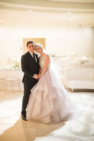 bride-in-blush-dress-with-groom-in-black-suit