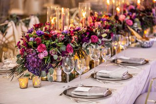 wedding-reception-mirror-runner-pink-purple-flowers-greenery-candle-votives-taper-candles