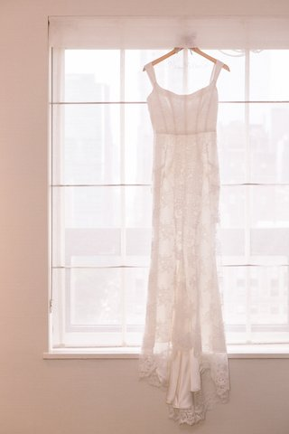 lace-bridal-gown-with-sheath-silhouette-on-custom-hanger