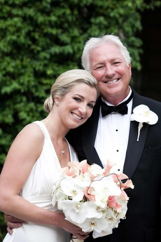 bride-with-orchid-bouquet-and-father-of-the-bride-in-tux