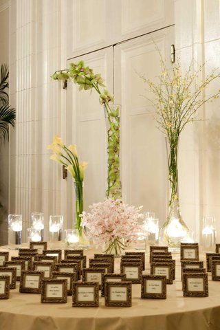 wedding-escort-card-table-with-orchid-flower-arrangements