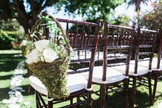 garden-wedding-reception-with-brown-chiavari-chairs-and-grassy-baskets-filled-with-white-roses