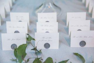 wedding-reception-outdoor-wedding-white-escort-cards-calligraphy-silver-grey-wax-seal-on-card