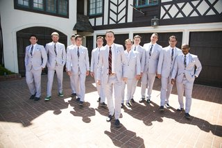 groom-and-groomsmen-in-casual-whipcord-suits