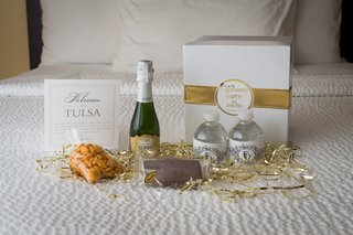 wedding-welcome-box-with-mini-water-bottles-champagne-goldfish-crackers