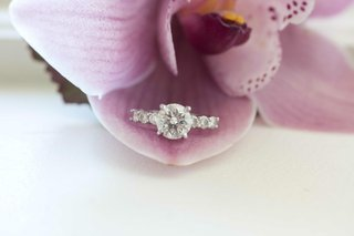 four-prong-round-diamond-engagement-ring-on-purple-orchid