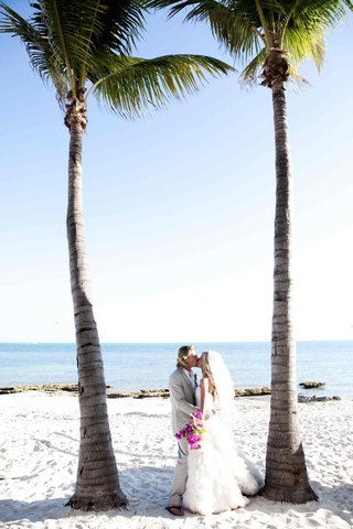 bride-and-groom-kiss-under-palm-trees-in-key-west