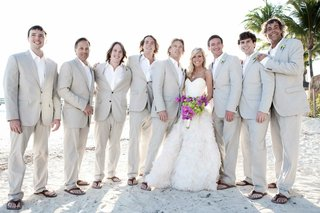 beach-wedding-bride-with-groom-and-casual-groomsmen