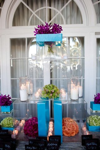 bright-blue-acrylic-boxes-with-candles-and-bright-flowers