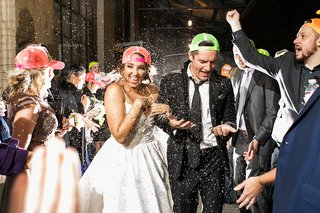 bride-and-groom-exit-with-confetti-thrown-wearing-neon-trucker-hats