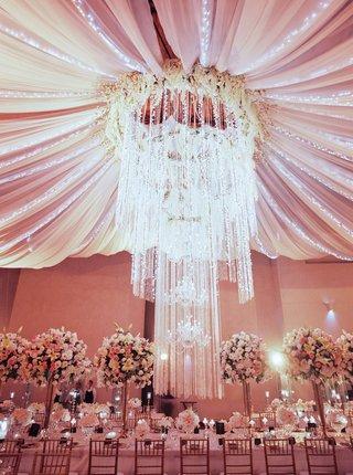wedding-reception-drapery-over-reception-table-cascading-chandelier-flower-halo-embellishments