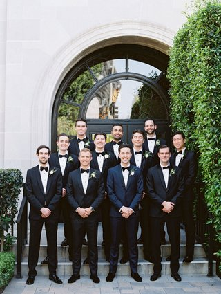 groom-in-navy-tuxedo-black-bow-tie-with-groomsmen-in-classic-suits-bow-ties-vibiana-wedding-venue-la