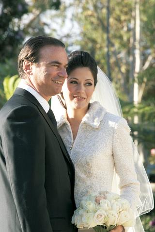 bride-wearing-unique-white-wedding-jacket