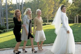 bride-in-white-jacket-and-ball-skirt-with-daryl-hannah