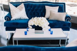 detriot-lions-quarterback-matthew-stafford-rehearsal-dinner-decor-blue-white-couch-flowers-candles