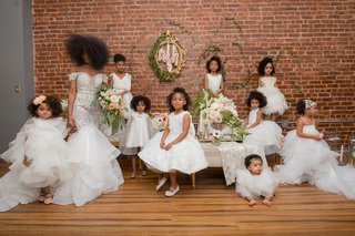 bride-with-natural-hair-in-pantora-bridal-dress-off-the-shoulder-pantora-mini-flower-girl-dresses
