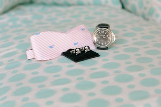 grooms-wedding-day-accessories-light-pink-and-white-stripe-bow-tie-skull-cufflinks-and-watch
