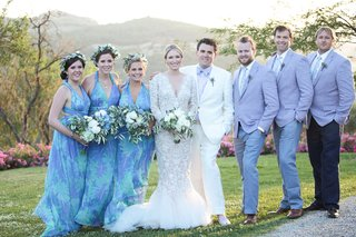bridesmaids-in-turquoise-and-lavender-infinity-dresses-groomsmen-in-lavender-suit-jackets