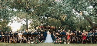 outdoor-wedding-ceremony-diamond-affairs-weddings-wood-vineyard-chairs-greenery-trees-pink-flowers