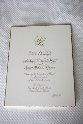 ivory-wedding-invite-with-gold-script-and-border
