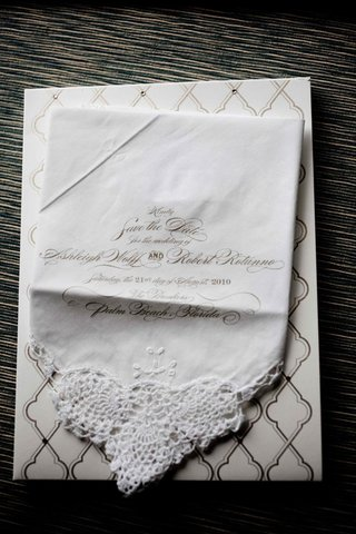 save-the-date-on-lace-edge-hankie-in-gold-script