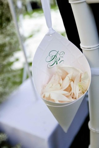 green-wedding-monogram-on-paper-cone-filled-with-flower-petals