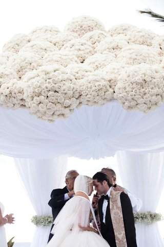 bride-and-groom-under-wedding-ceremony-structure