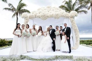 white-bridesmaid-dresses-and-tuxedos-oceanfront-ceremony