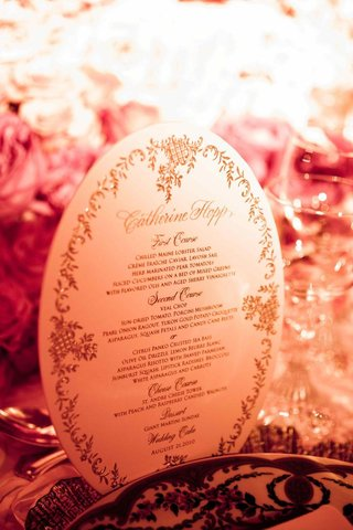 oval-shape-wedding-dinner-menu-card-with-gold-print