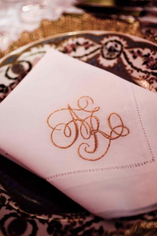 white-linen-napkin-with-sparkling-gold-monogram-initials