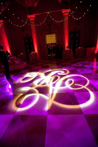wedding-reception-violet-lighting-with-initial-projected-on-floor