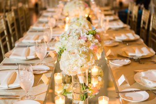 floral-centerpieces-along-the-table-on-mirror-runner-white-and-blush-flowers-low-flower-arrangements