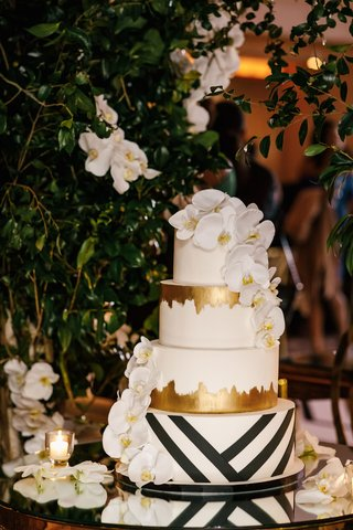 wedding-cake-four-layer-black-white-stripe-geometric-design-gold-foil-and-white-orchid-decorations