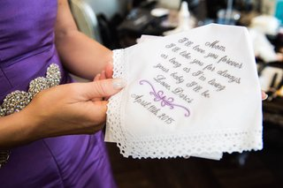 mother-of-the-bride-holding-embroidered-handkerchief-with-personalized-letter