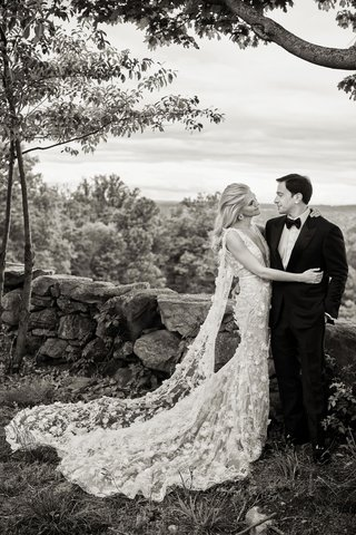 black-and-white-photo-of-bride-and-groom-at-new-york-farm-venue-marchesa-wedding-dress-tuxedo