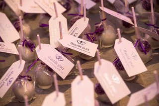 cake-pop-wedding-favors-with-purple-ribbon-and-thank-you-for-celebrating-with-us-tags
