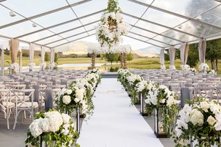 open-side-clear-tent-wedding-ceremony-ranch-aspen-colorado-white-flowers-antlers-decor-lanterns