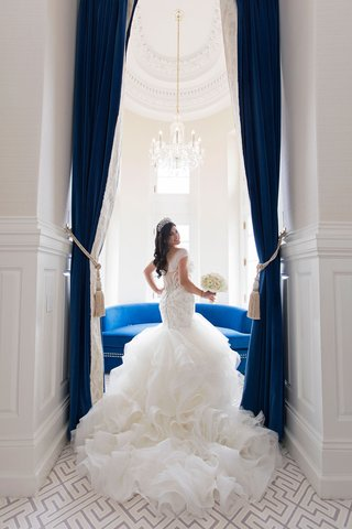 bride-in-tiara-long-hair-matthew-christopher-wedding-dress-ruffle-skirt-mermaid-illusion-back